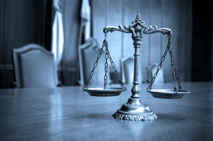 scales of justice on desk