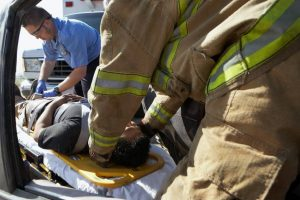 firefighter with car accident victim