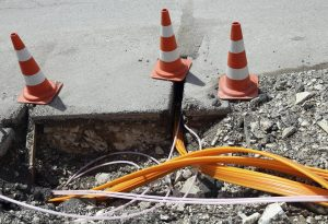Road construction with pipes for laying optical fiber for high speed internet