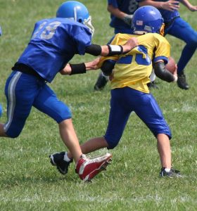 kids football game tackle
