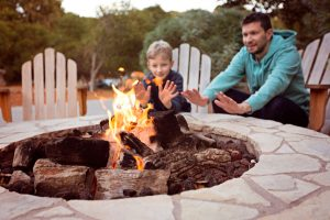 outdoor fire pit dad and son
