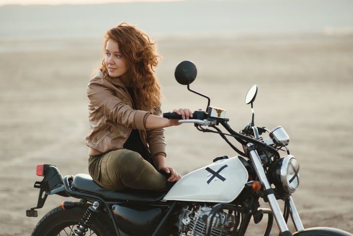 woman on motorcycle on beach